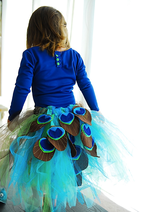 flower girl in a peacock tutu